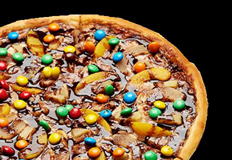 Пицца шоколадная с фруктами.